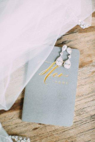wedding-jewelry-accessories-diamond-drop-earrings-teardrop-pear-shape-gold-foil-her-vows-booklet