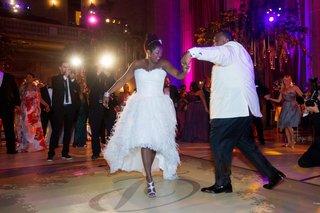 african-american-couple-dancing-on-monogrammed-floor