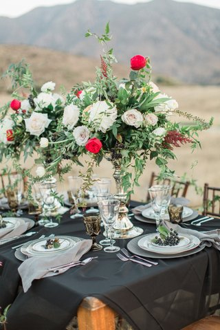 rustic-tablescape-dark-linen-bold-arrangement-black-sheer-mercury-vase-red-white-green-flowers-boho