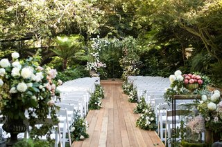 wedding-ceremony-hotel-bel-air-geller-events-the-hidden-garden-fall-flowers-white-chairs-wood-plank