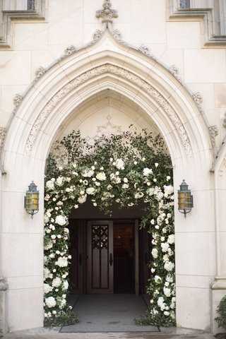 church-ceremony-entrance-archway-with-greenery-white-flowers-decorating-arch