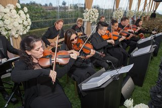wedding-ceremony-clear-tent-white-flowers-musicians-in-black-outfits-with-violin-viola-string