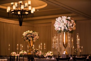 indian-wedding-reception-ballroom-chandelier-gold-vase-tall-candelabra-pink-white-flowers-rose