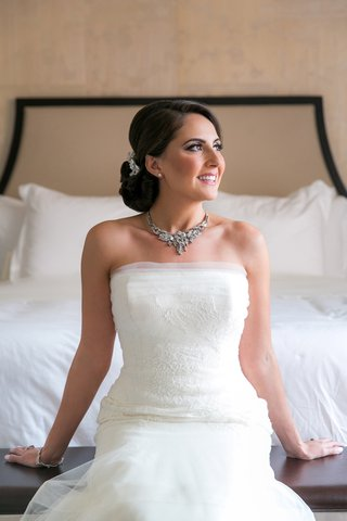 bride-posing-on-bed-accessories-silver-shiny-classic-diamonds-crystals-wedding