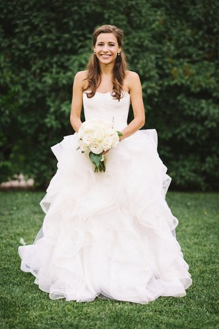 bride-wearing-wedding-dress-and-holding-bouquet