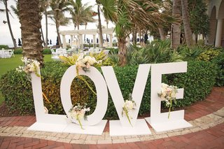 large-letters-spelling-love-lead-to-the-entrance-of-the-reception