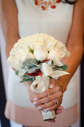 brides-wedding-shower-bouquet-of-white-roses-greenery-red-chilies-tied-in-white-satin-ribbon
