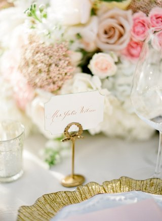 wedding-reception-place-card-in-a-gold-holder