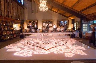 wedding-reception-dance-floor-rose-gold-heart-monogram-light-projections-chandelier