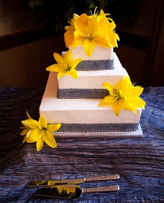three-layer-wedding-cake-with-yellow-flowers