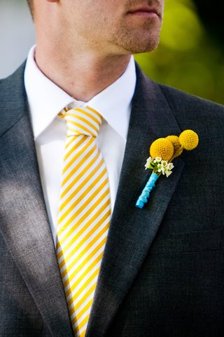 groom-in-yellow-stripe-tie-and-yellow-billy-buttons-boutonniere