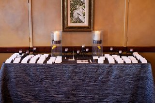 blue-crinkle-linens-on-seating-card-table-with-calla-lily
