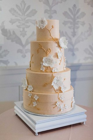 four-layer-wedding-cake-round-tiers-buttercream-white-sugar-flowers-gold-vines-blush-frosting