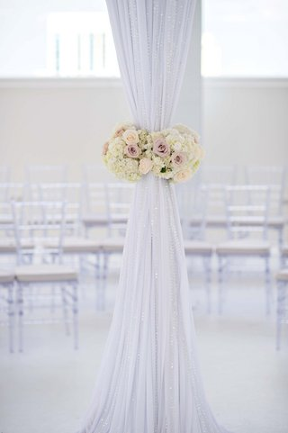 wedding-canopy-fabric-tied-with-romantic-floral-belt