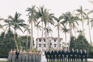 henry-morrison-flagler-museum-wedding-large-bridal-party-in-front-of-palm-trees