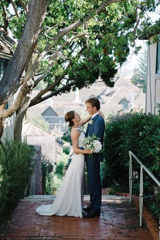 bride-groom-first-look-oceanside-california-small-town-blue-suit-suzanne-neville-dress-bouquet-trees