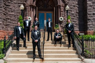 groom-and-friends-standing-on-stone-steps