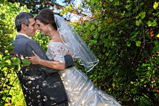 bride-and-groom-in-forest-with-short-wedding-veil