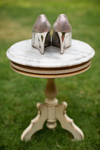 shiny-metallic-jimmy-choo-wedges-on-marble-table