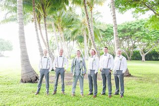 groom-in-grey-suit-groomsmen-in-grey-slacks-and-suspenders