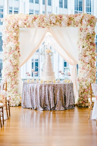styled-shoot-with-silver-sequin-round-table-cake-display-and-silver-cake-under-chuppah
