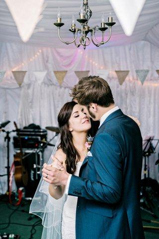 bride-and-groom-dance-close-wedding-reception-diy-english-british-garden-wedding-blue-suit-pink