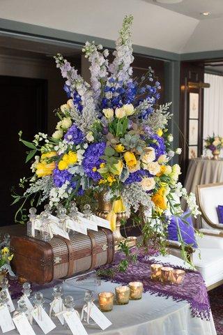 grand-purple-yellow-arrangement-display-new-york-city-bridal-shower-trunk-bottles