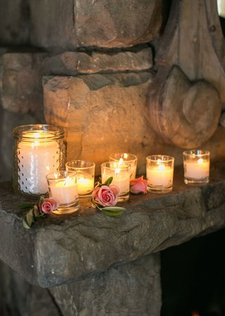 wedding-reception-in-adobe-room-of-san-ysidro-ranch-with-candles-pink-roses-leaves-on-mantle