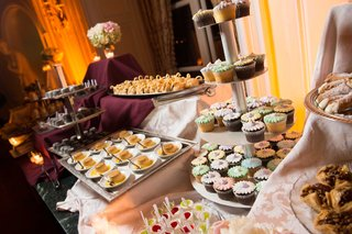 wedding-dessert-table-with-cupcakes-on-tiered-stand-flan-swan-desserts-cannoli-treats