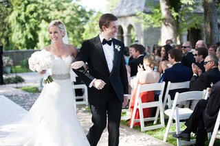 happy-newlyweds-walk-back-up-the-aisle-after-their-outdoor-ceremony