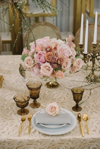 soft-champagne-colored-linen-with-embroidery-and-gold-dinnerware-low-rose-centerpiece-candelabrum