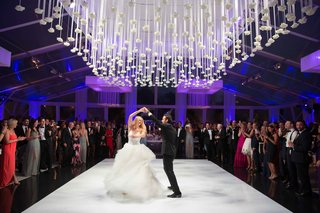 purple-lighting-glass-tent-wedding-reception-with-flower-ceiling-treatment-vera-wang-wedding-dress