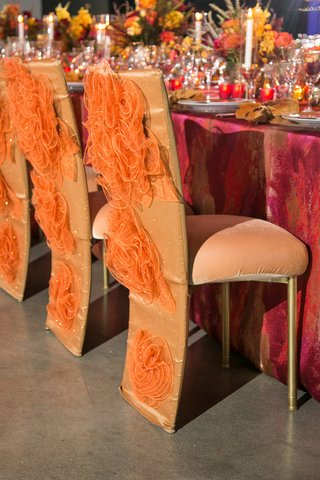 fire-inspired-wedding-styled-shoot-glittery-orange-decorative-chair-covers