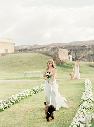 puerto-rico-wedding-ceremony-san-cristobal-fort-white-flowers-bridesmaids-pastel-walking-dogs
