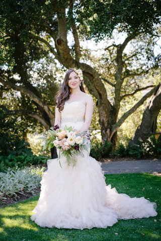 bride-in-blush-ruffled-mermaid-dress-floral-hairband-fresh-picked-bouquet