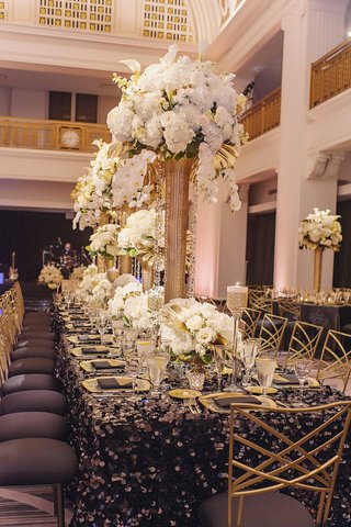 renaissance-hotel-cincinnati-wedding-gold-chameleon-chairs-with-black-cushions-sequin-black-linens