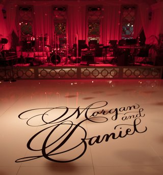 wedding-reception-decoration-ideas-white-dance-floor-with-calligraphy-names-on-dance-floor-tiles