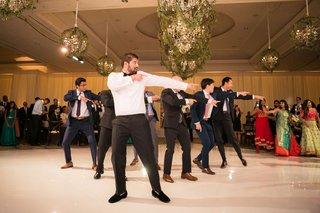 wedding-reception-indian-wedding-dancing-groom-and-groomsmen-doing-dance-on-white-dance-floor