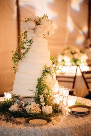 tall-six-tier-wedding-cake-round-with-white-frosting-ivory-peony-flowers-greenery