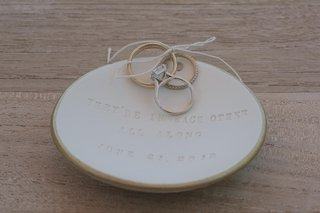 rings-tied-to-dish-inscribed-with-poem