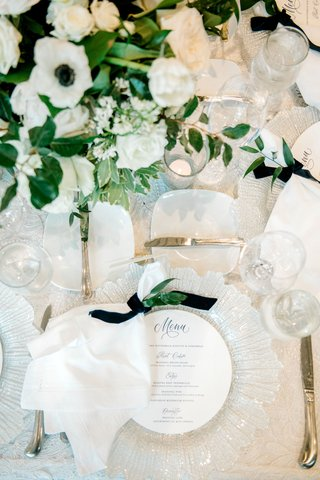 wedding-reception-place-setting-glass-charger-circle-menu-blue-script-velvet-navy-ribbon-napkin