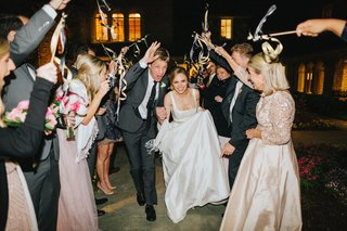 bride-and-groom-wedding-grand-exit-as-guests-wave-streamers