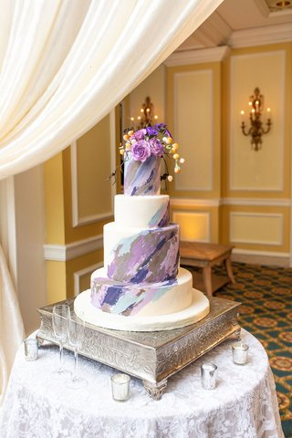 wedding-cake-four-layer-with-purple-blue-grey-brush-stroke-design-and-flowers-on-top-silver-base