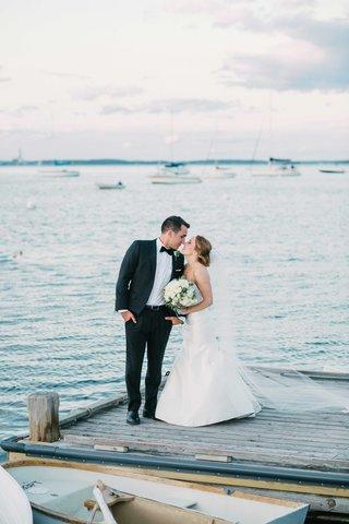 bride-groom-kiss-on-dock-maine-atlantic-ocean-cape-elizabeth-rivini-green-wedding-color-palette-sea