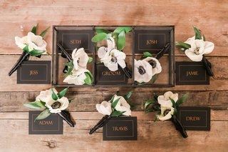 two-flower-boutonniere-with-named-box-anemone-flowers