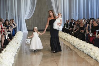 bridesmaid-walks-her-daughters-and-flower-girls-down-the-aisle