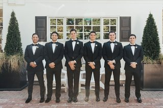 groom-and-groomsmen-in-tuxedos-at-admirals-house-in-seattle-classic-wedding-attire