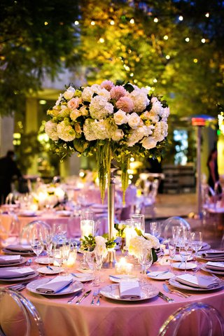 tall-wedding-centerpiece-round-table-clear-chairs-pink-dahlia-white-hydrangea-rose-amaranthus