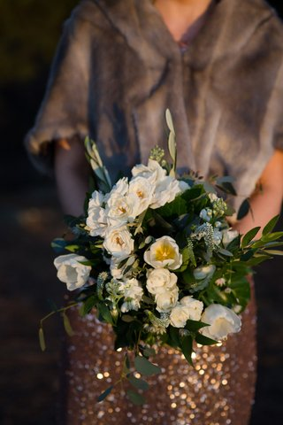 wedding-bouquet-bridesmaids-sparkle-dress-fur-wrap-greenery-bouquet-white-flowers-rose-tulip-blooms