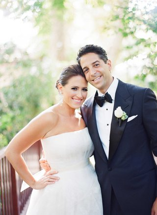 bride-in-strapless-vera-wang-gown-with-updo-and-groom-in-midnight-blue-tuxedo